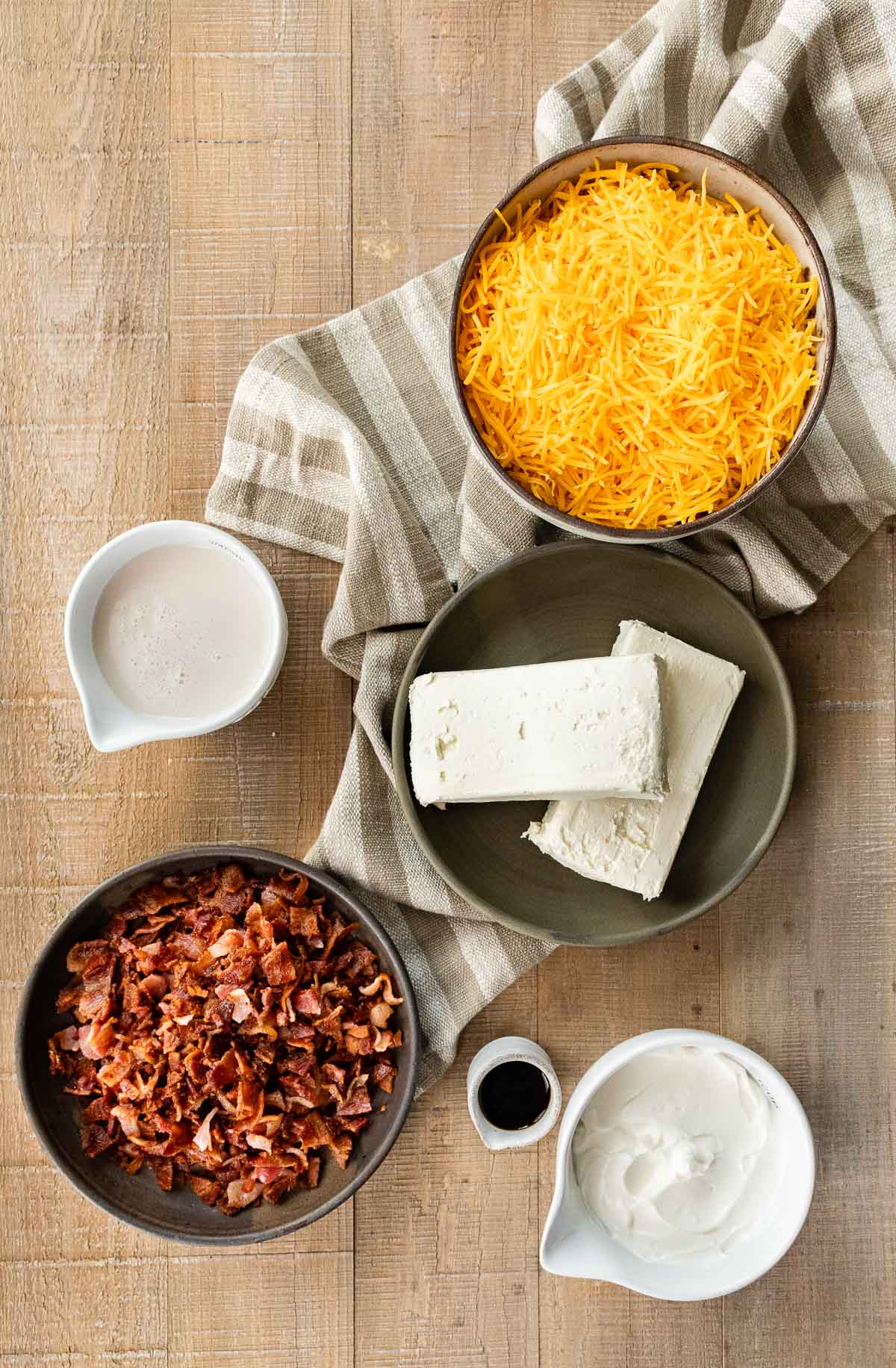 Ingredients for Hot Bacon Cheese Dip in prep bowls