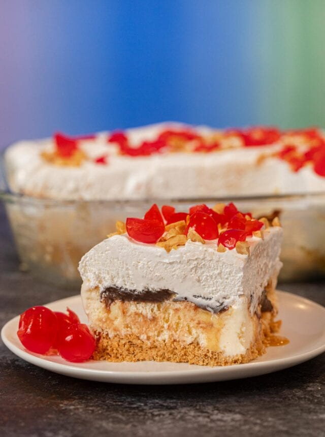 Ice Cream Sundae Casserole serving on plate with maraschino cherries