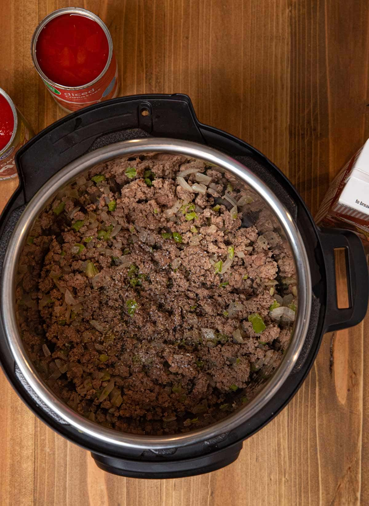 Instant Pot Hamburger Soup ground beef and onions in pressure cooker