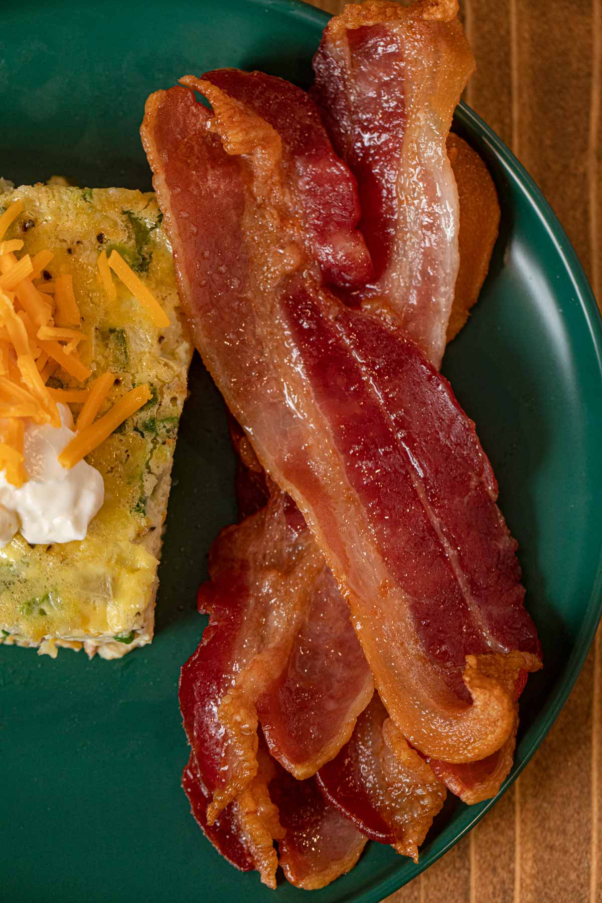 Oven Baked Bacon on plate with eggs