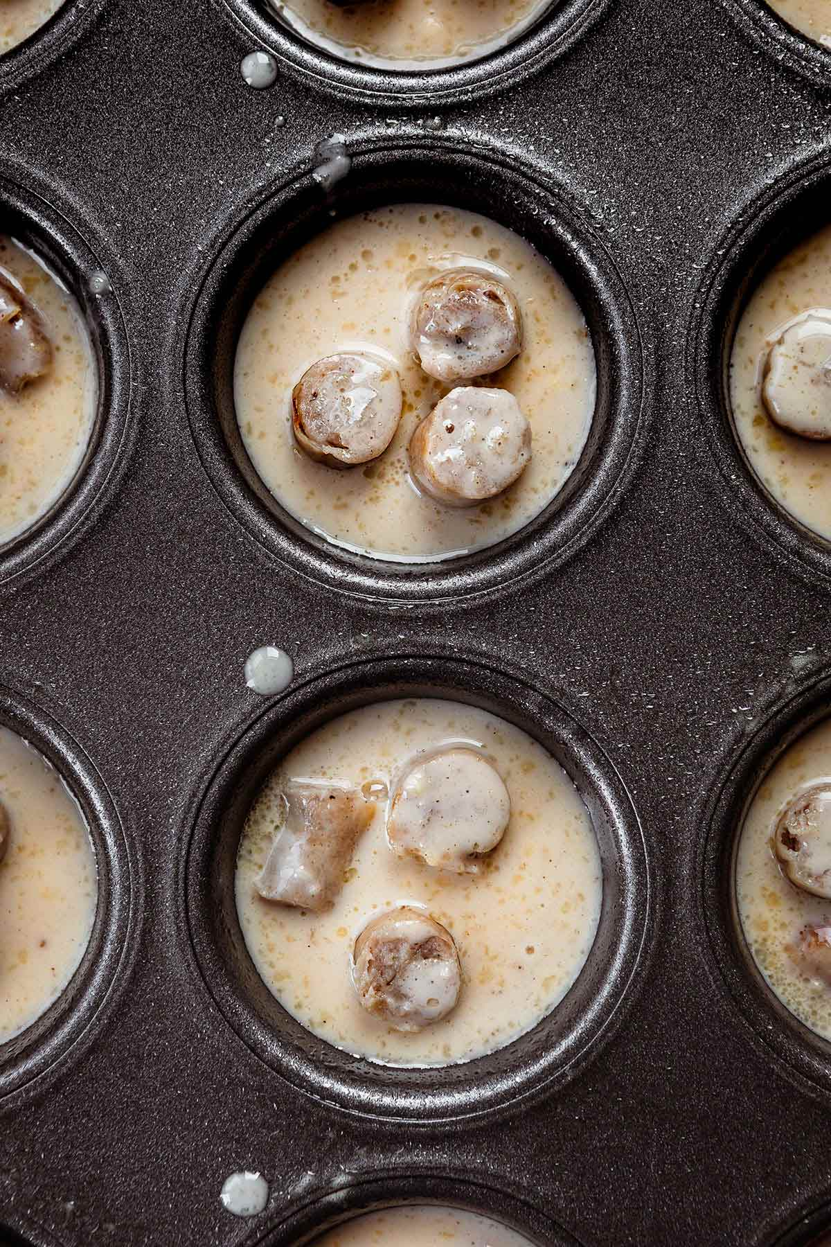 Pigs in a Pool in muffin tins before baking