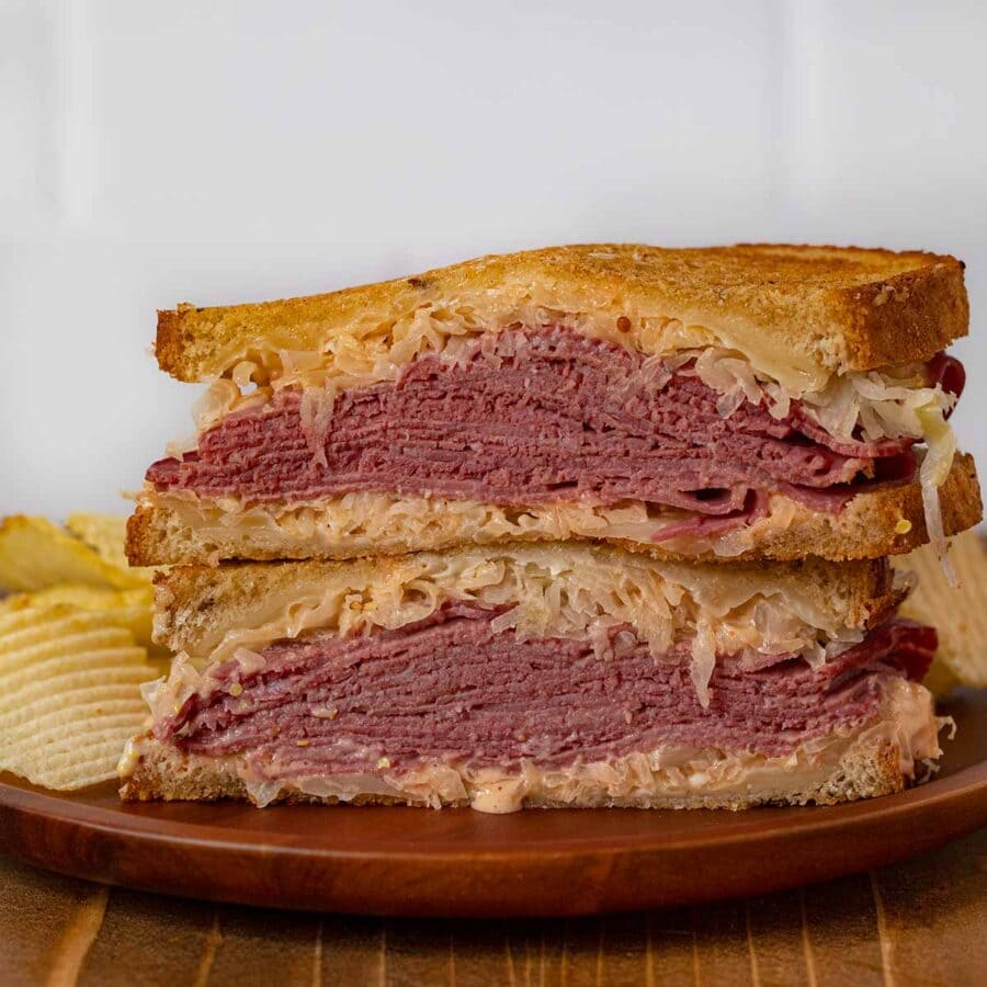 Reuben Sandwich on plate with chips