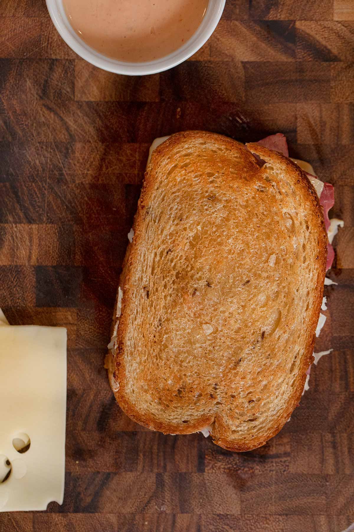top-down view of Reuben Sandwich on cutting board