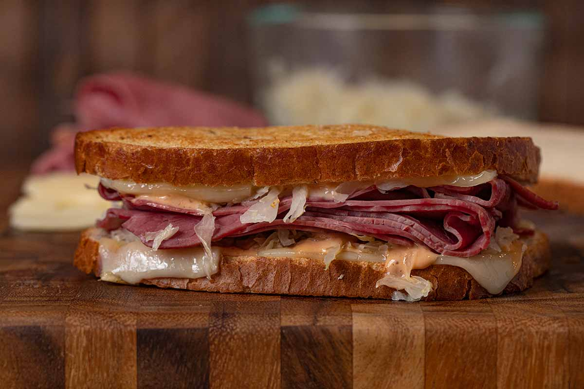 close-up of Reuben Sandwich on cutting board