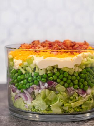 Seven Layer Salad side view in glass bowl