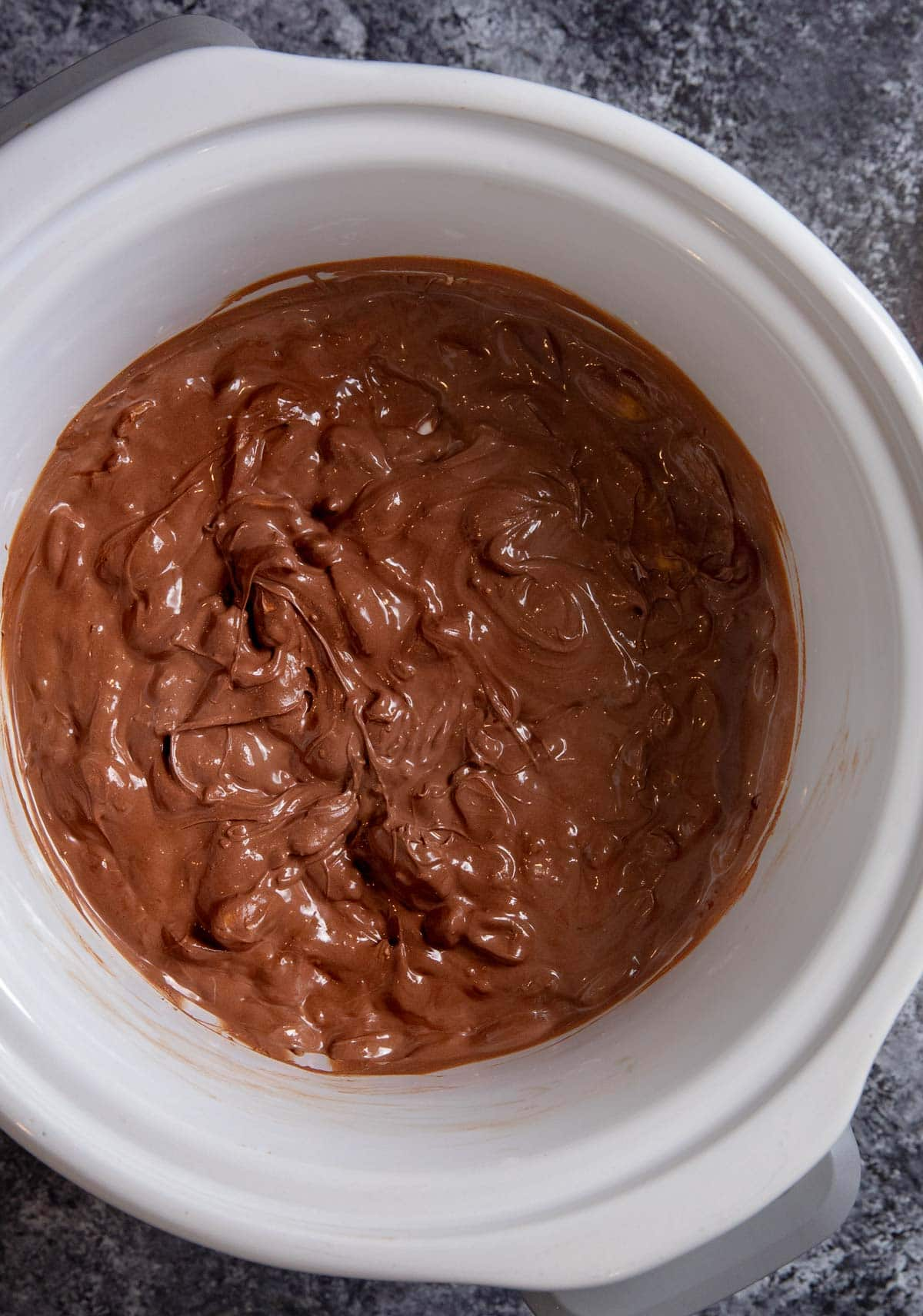 Slow Cooker Chocolate Candy melted chocolate and peanuts in crockpot