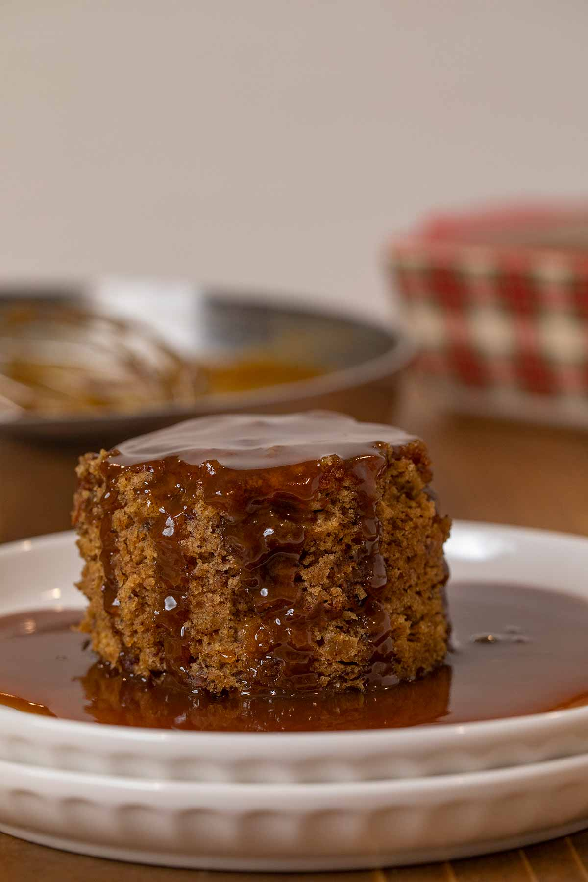 Sticky Toffee Pudding serving on plate with sauce