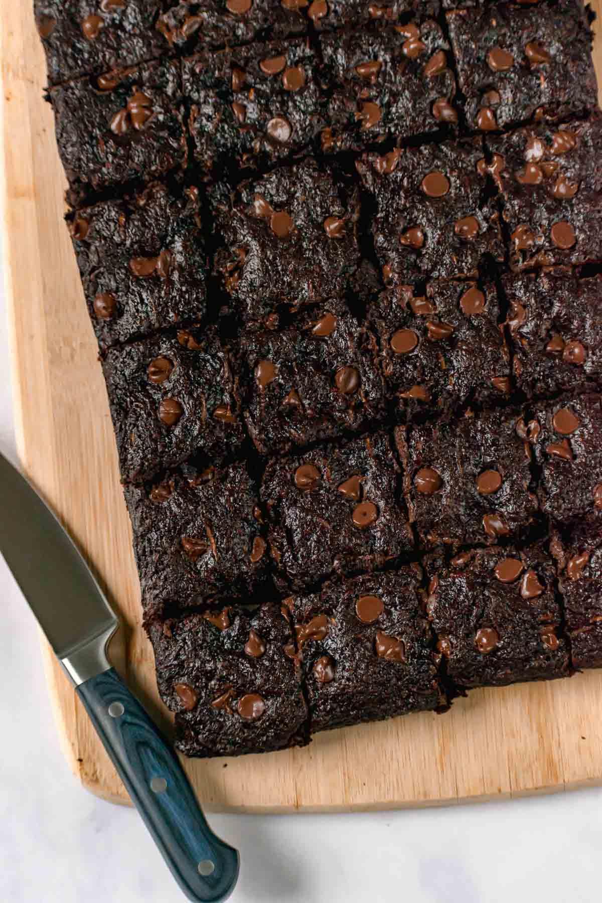 Sliced Zucchini Brownies on cutting board