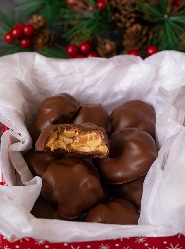 Caramel Peanut Clusters in Christmas gift box
