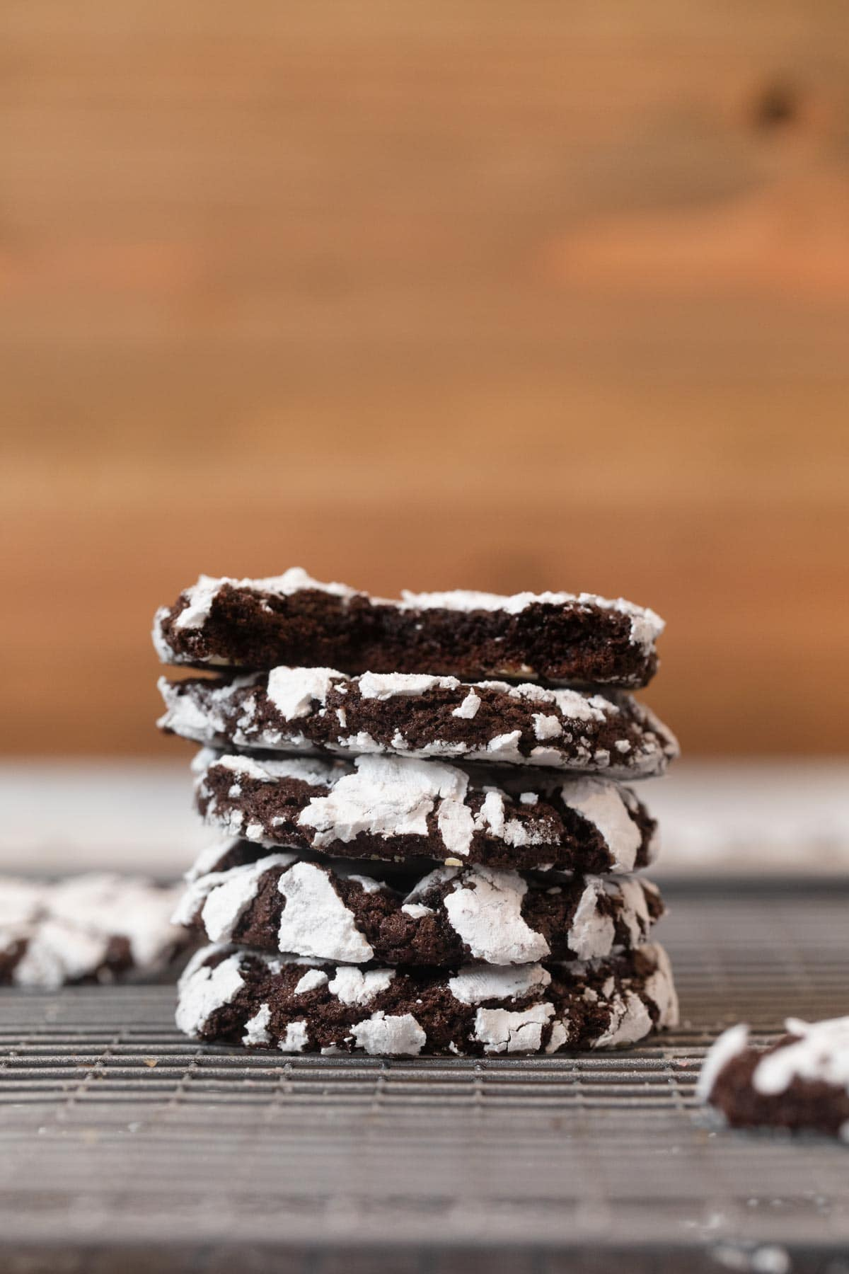Chocolate Crinkle Cookies in stack with top cookie bitten in half