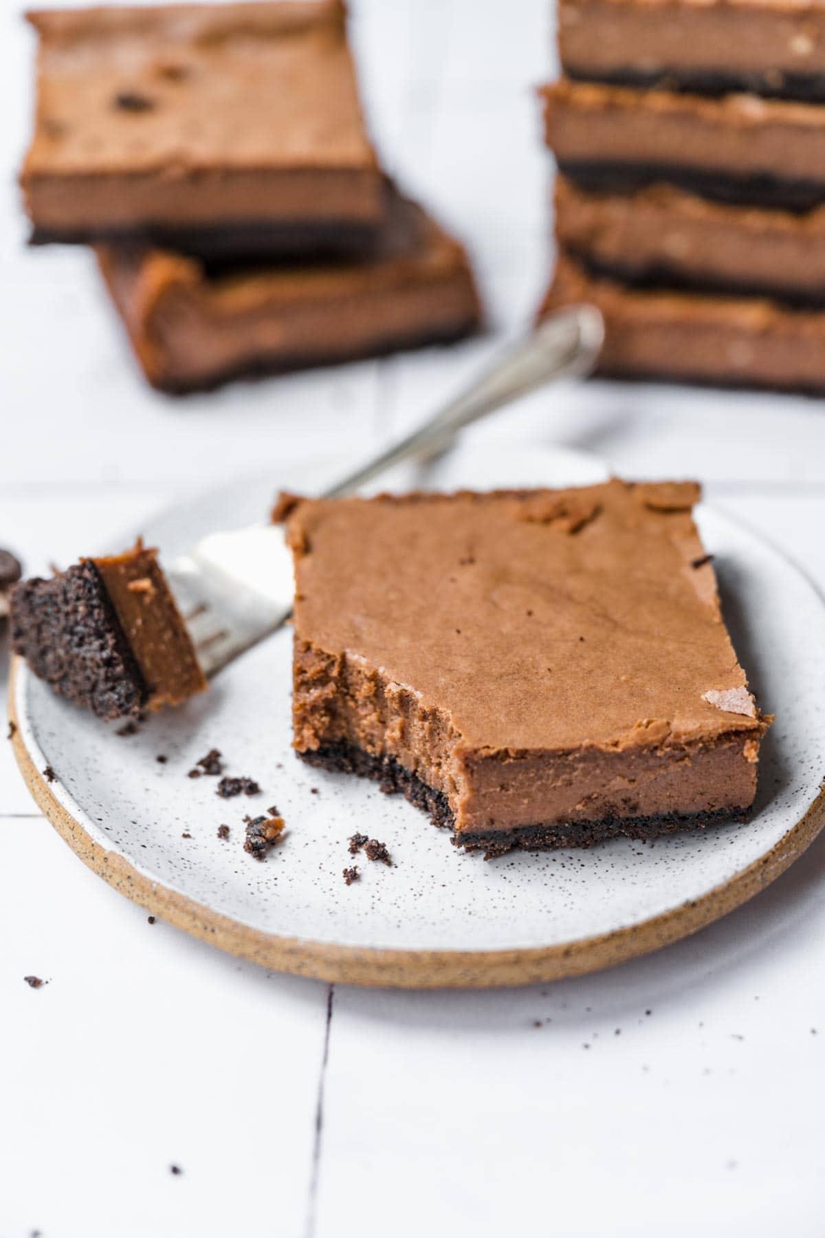 Chocolate Cheesecake Bars sliced on plate