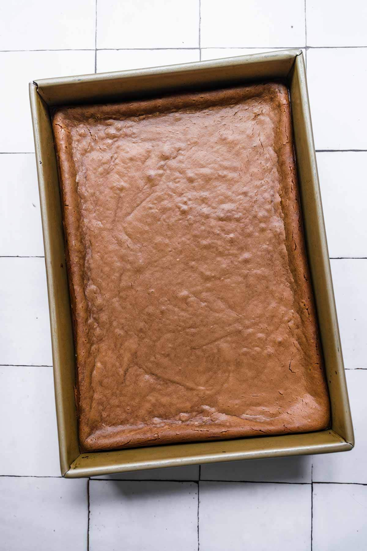 Chocolate Cheesecake Bars in baking dish after baking