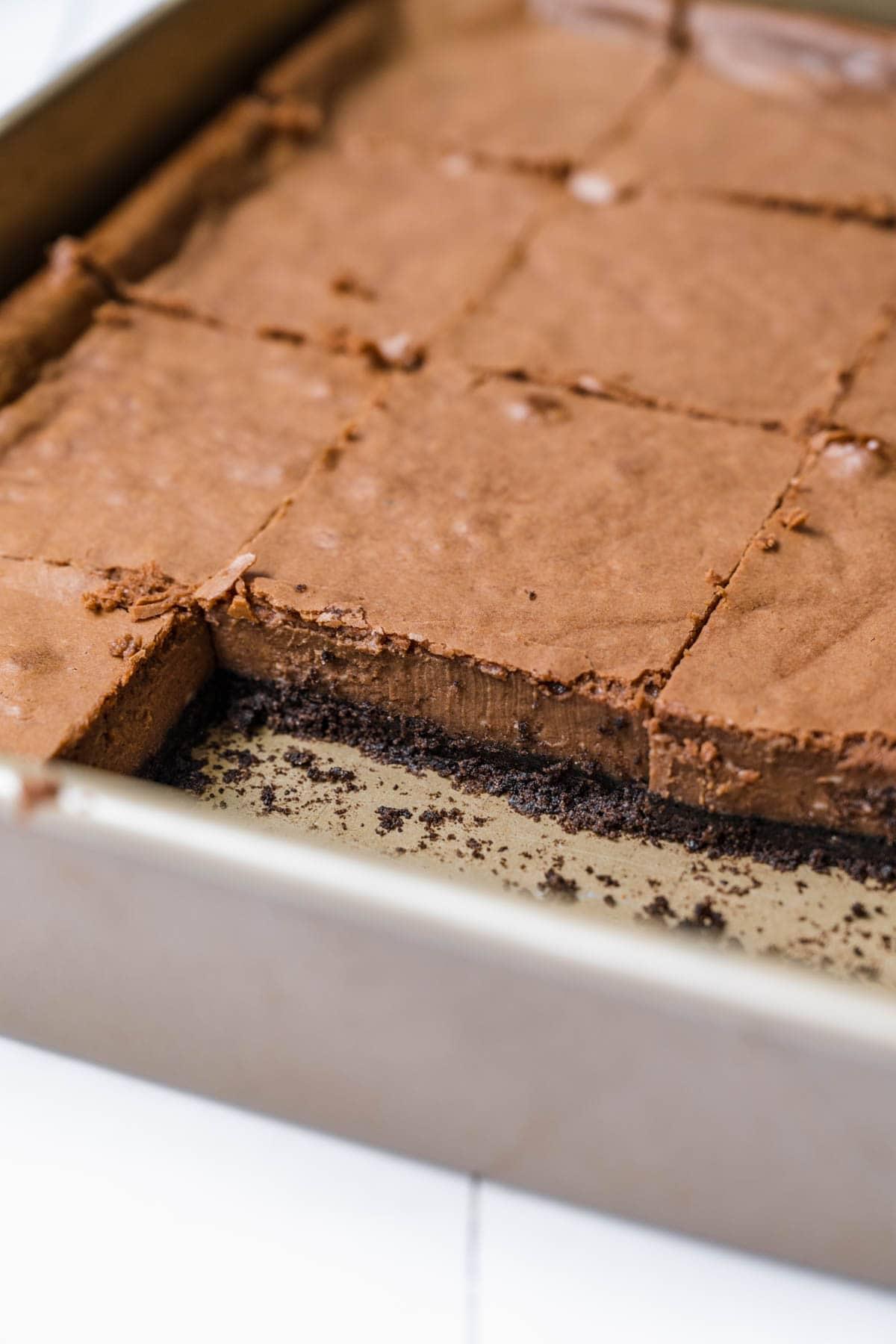 Chocolate Cheesecake Bars sliced in baking dish