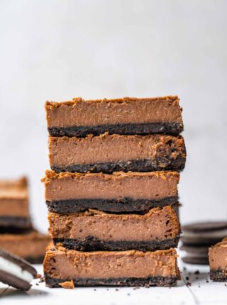 Chocolate Cheesecake Bars sliced and stacked
