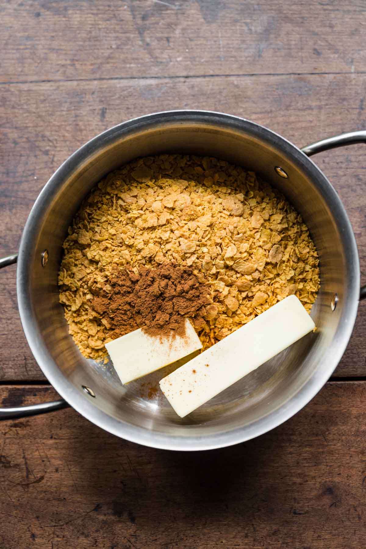 Butter and cornflakes in saucepan for Fried Ice Cream Dessert Casserole