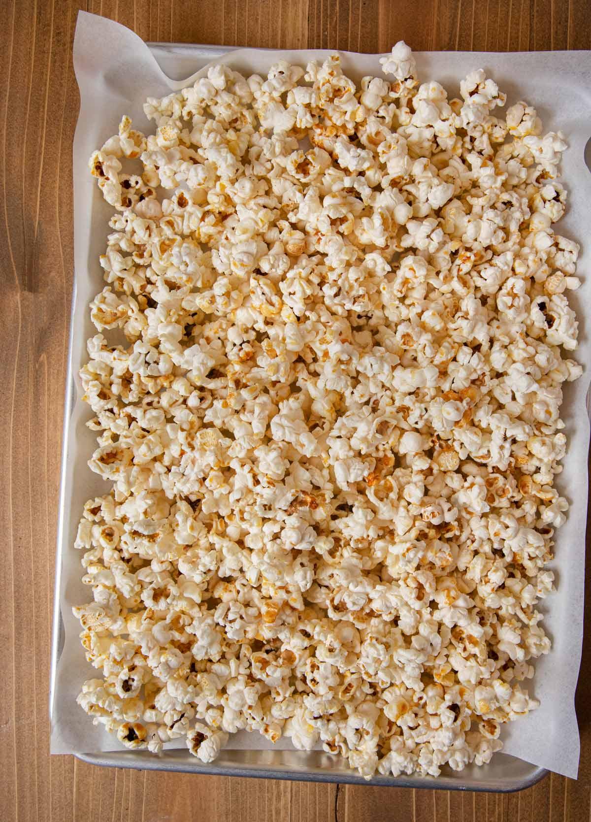 Kettle Corn spread out on baking sheet