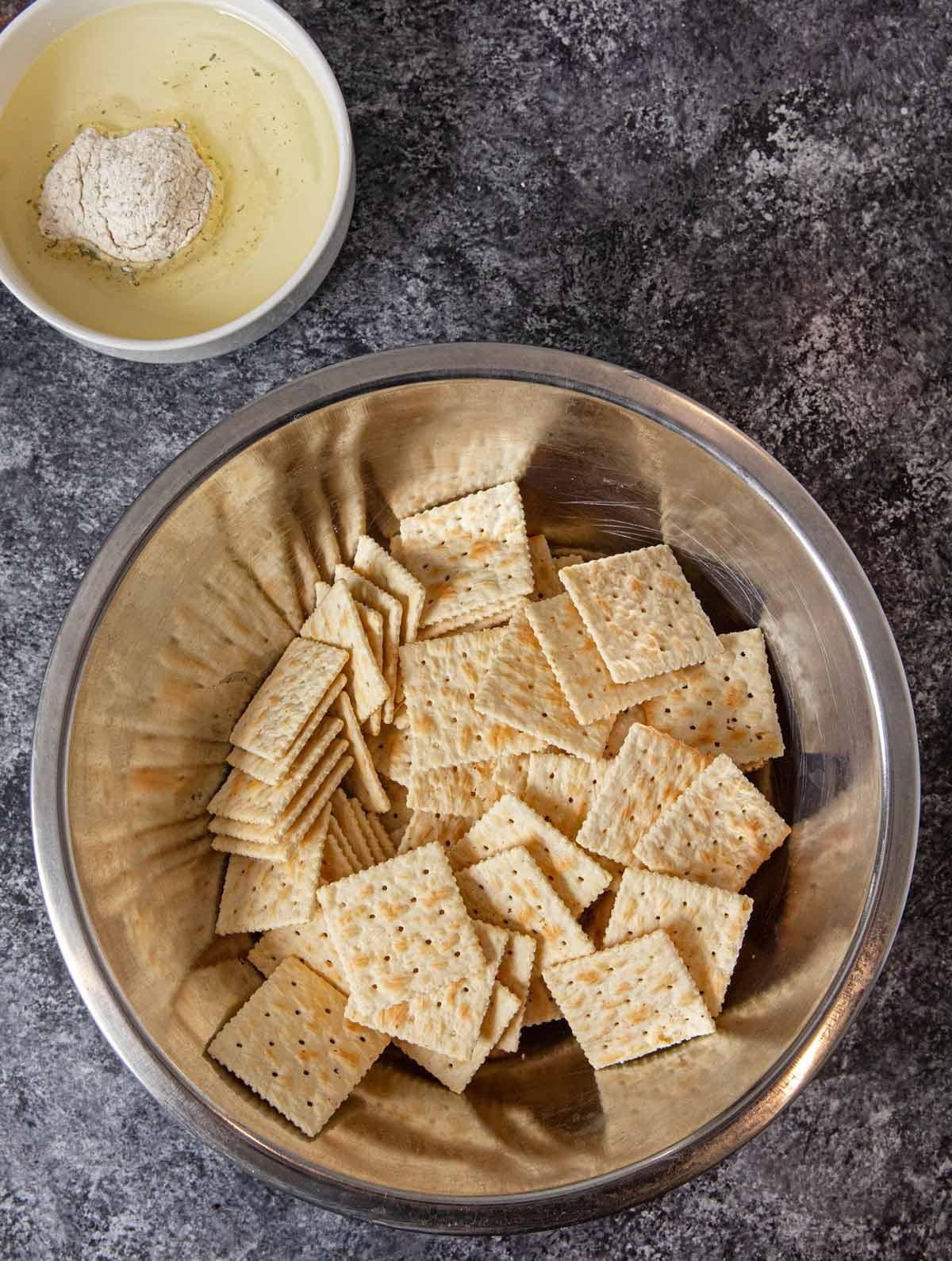 Ranch Mix Saltines ingredients in bowls