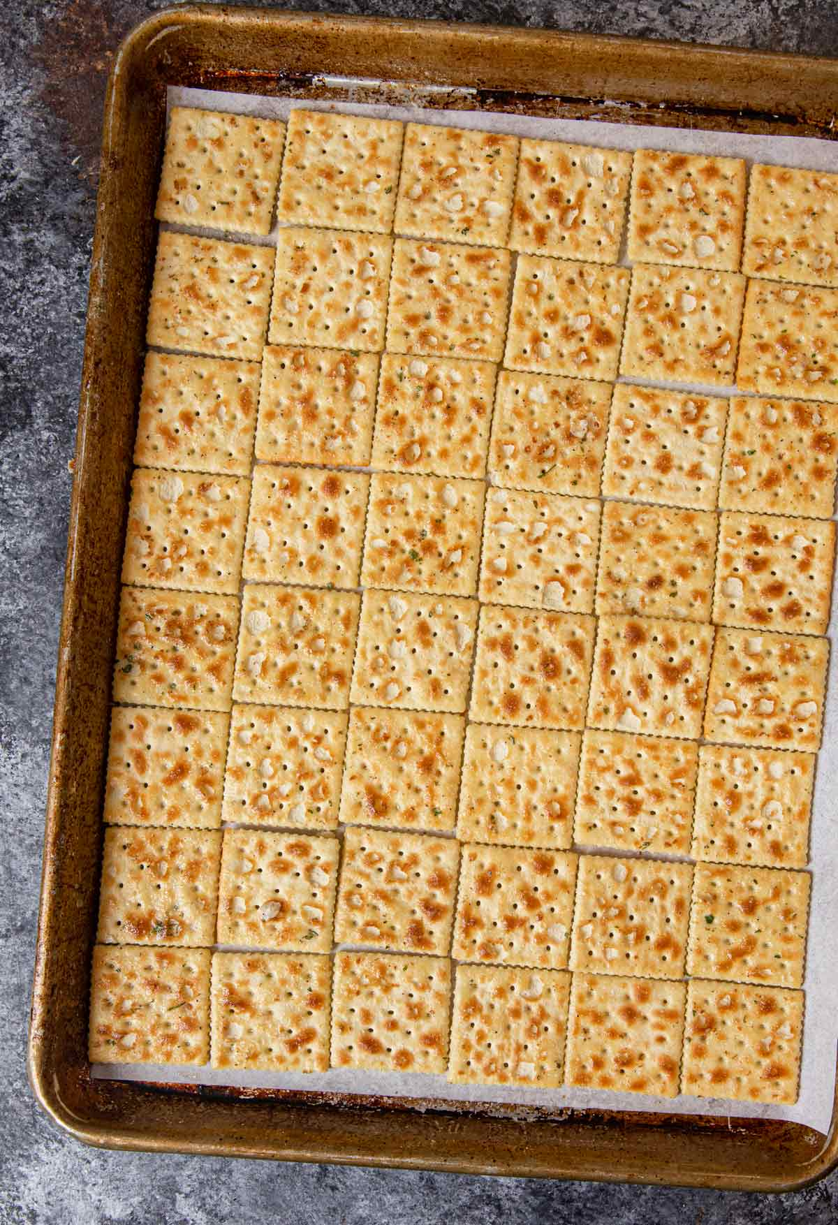 Ranch Mix Saltines lined up on baking sheet
