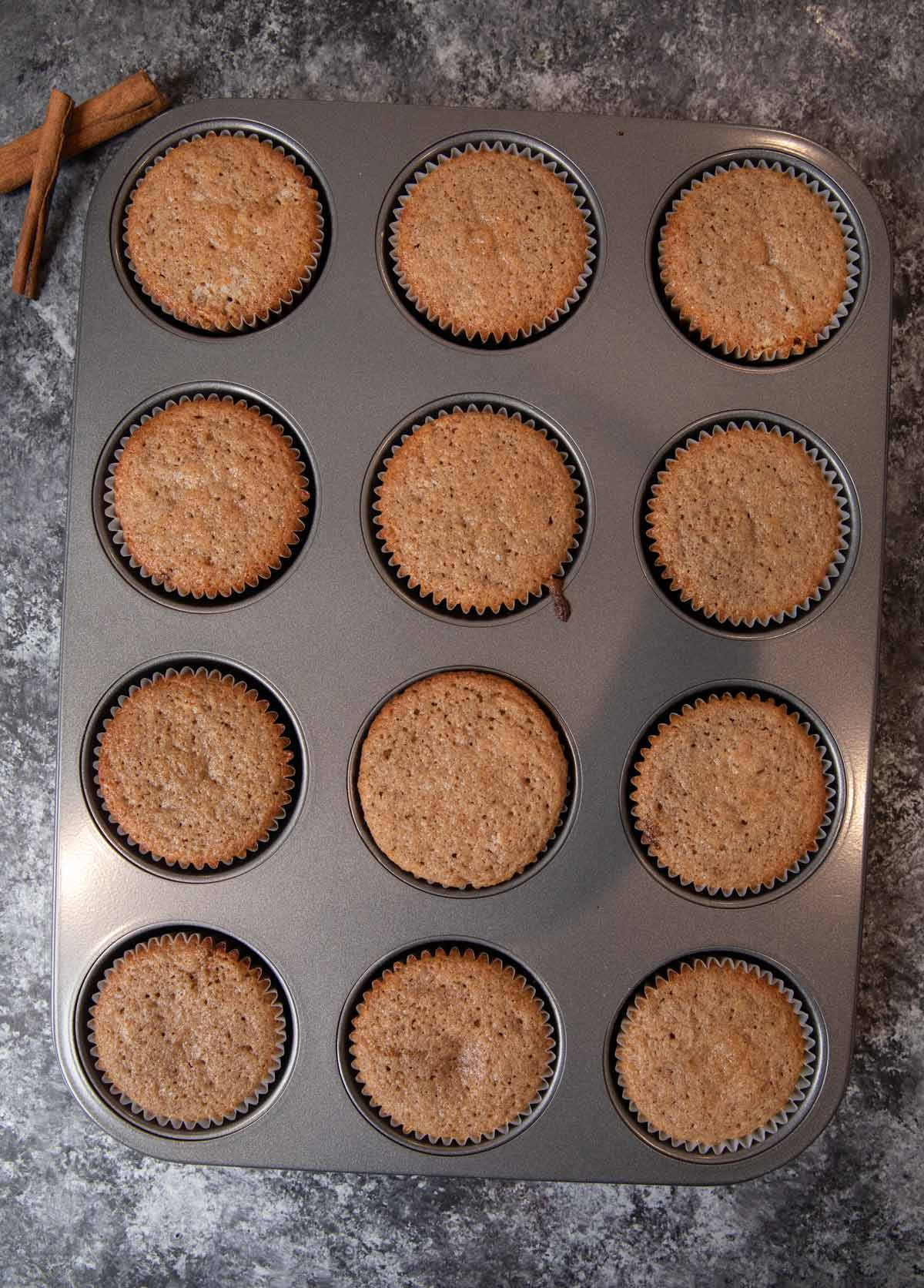 Snickerdoodle Cupcakes in muffin tin