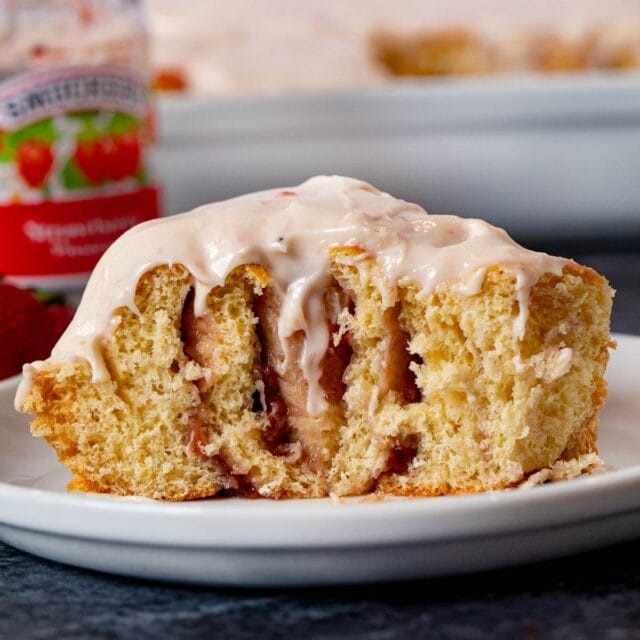 Strawberry Roll sliced in half on plate