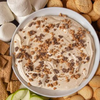 Toffee Apple Dip bowl on tray with foods for dipping