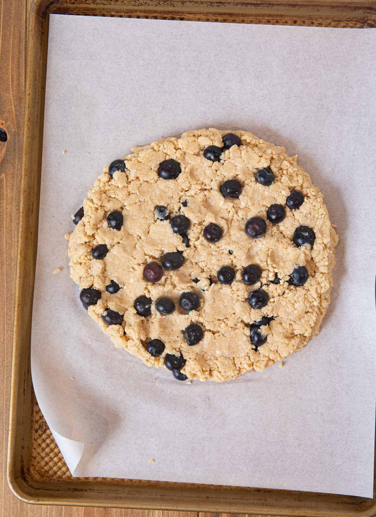 Blueberry Scones dough in flattened circle on cookie sheet