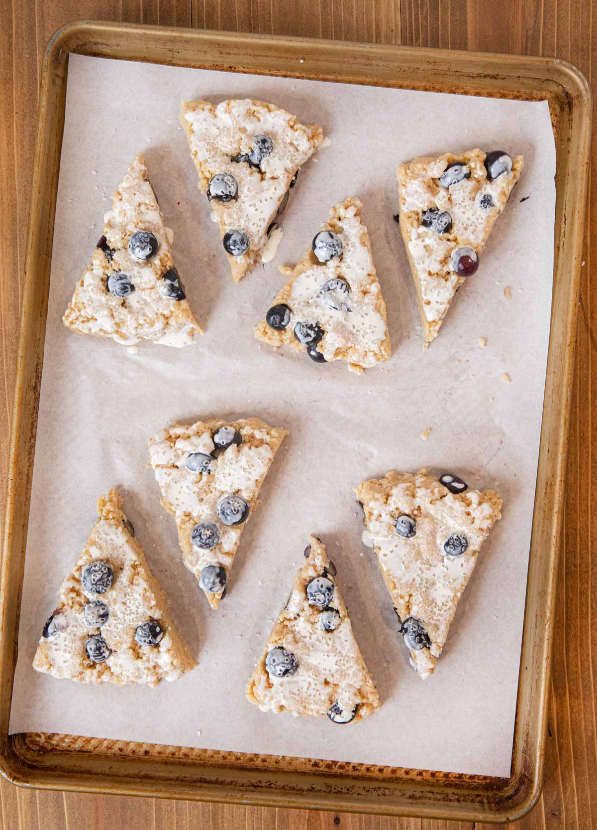Blueberry Scones unbaked sliced scone wedges on cookie sheet