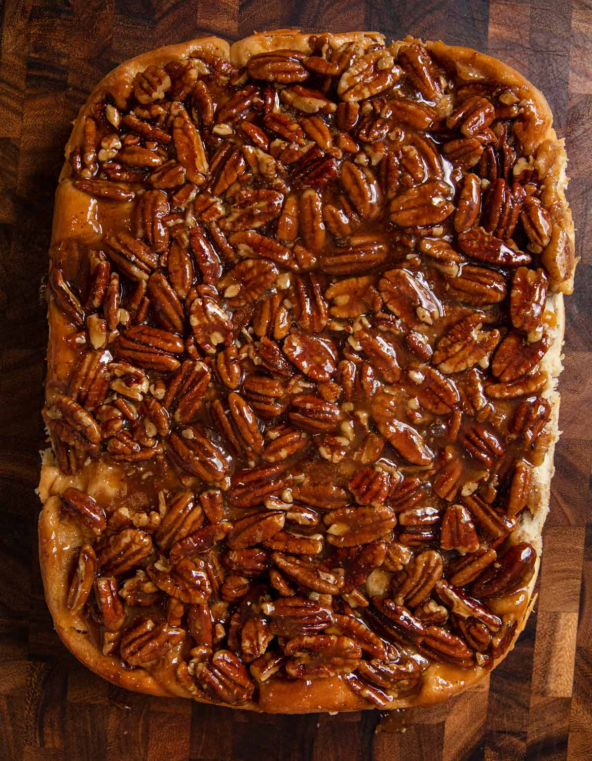 baked Caramel Pecan Cinnamon Rolls on cutting board