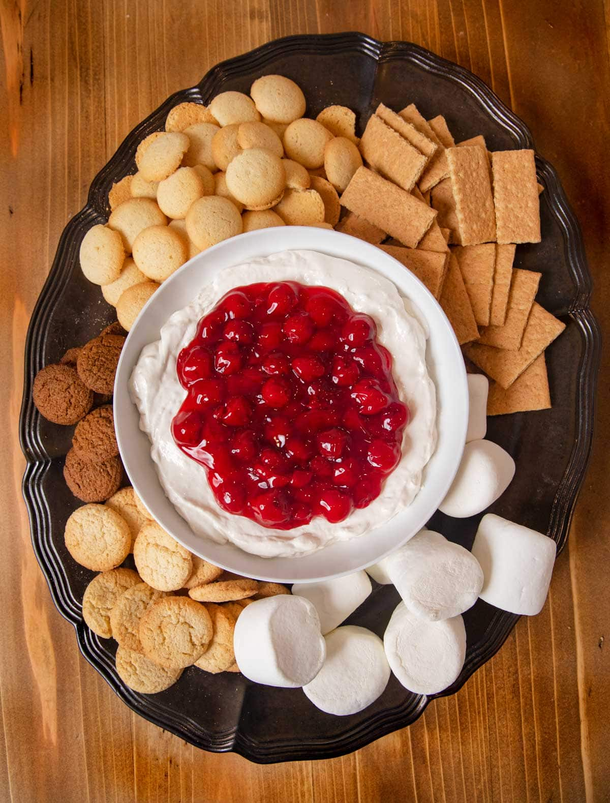 Cherry Cheesecake Dip on dessert platter with assorted dippers