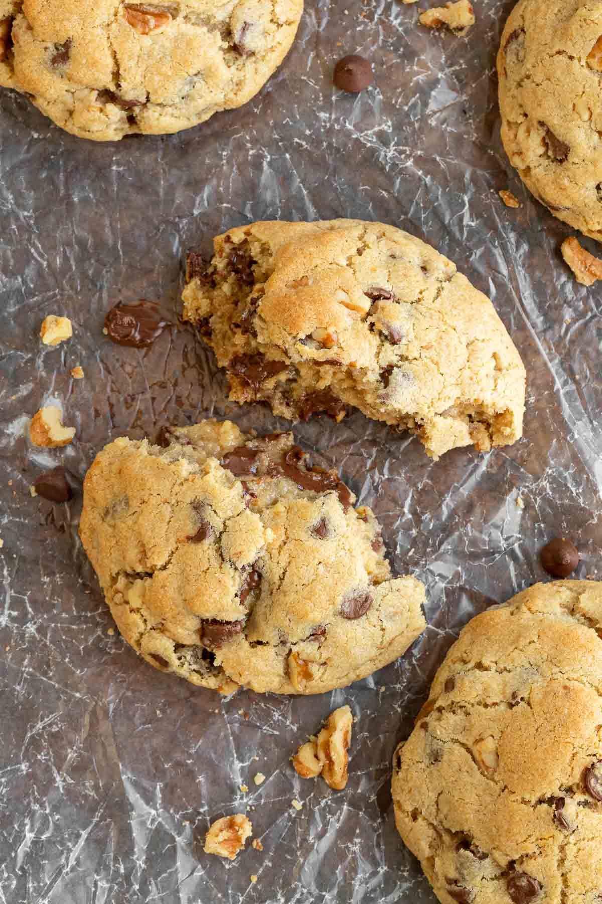 Levain Chocolate Chip Cookies broken in half on baking sheet