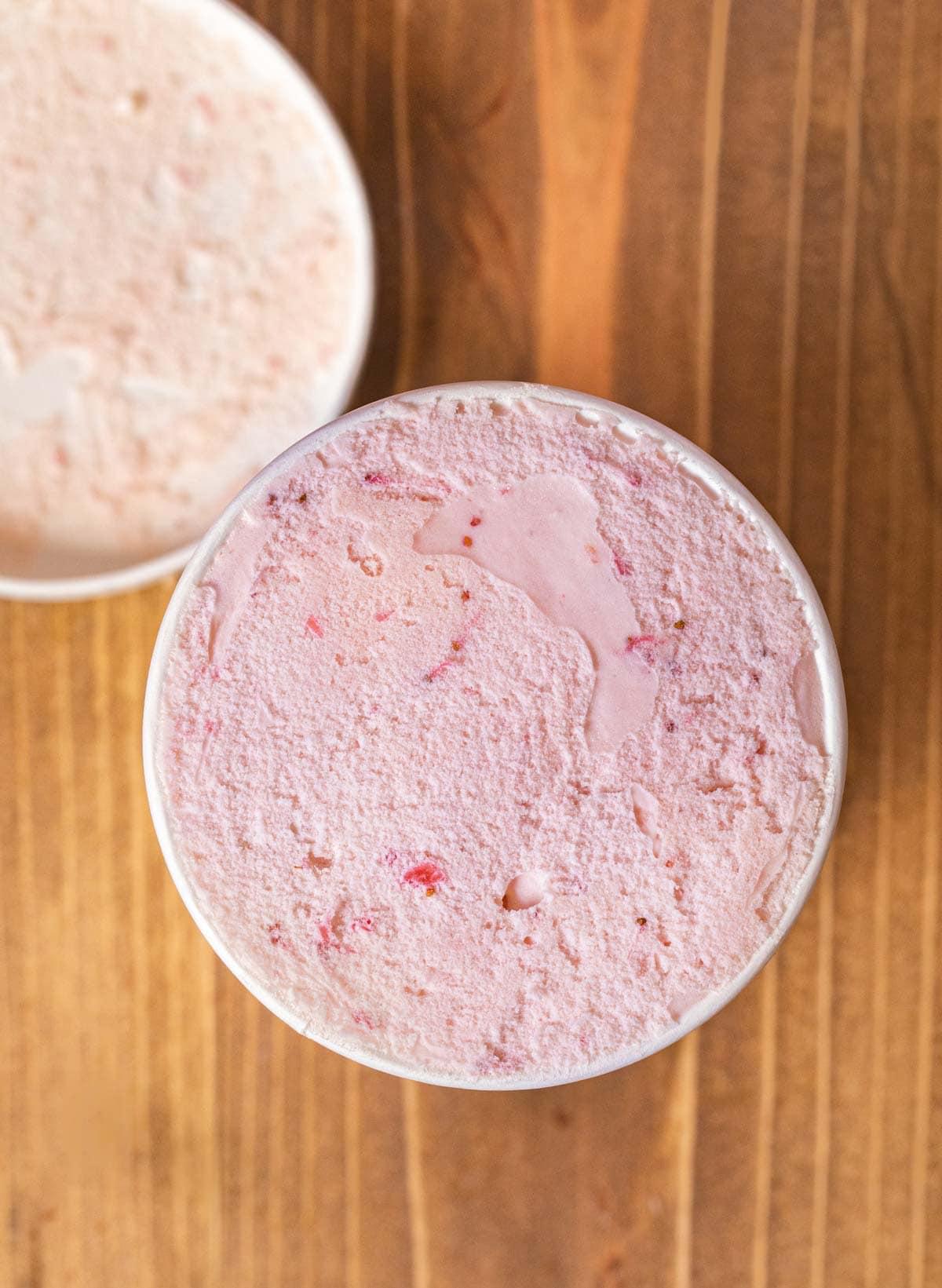 Strawberry Ice Cream in ice cream freezer carton