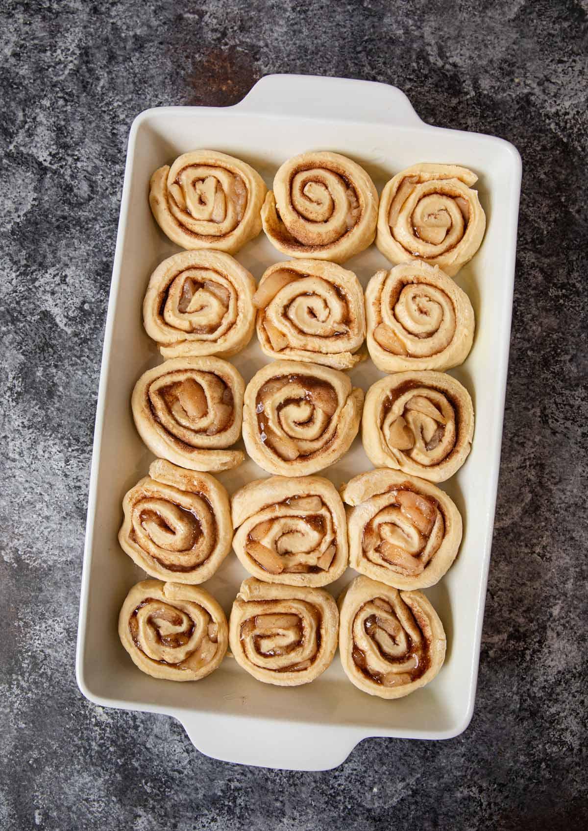 Apple Crisp Cinnamon Rolls in baking dish before proofing