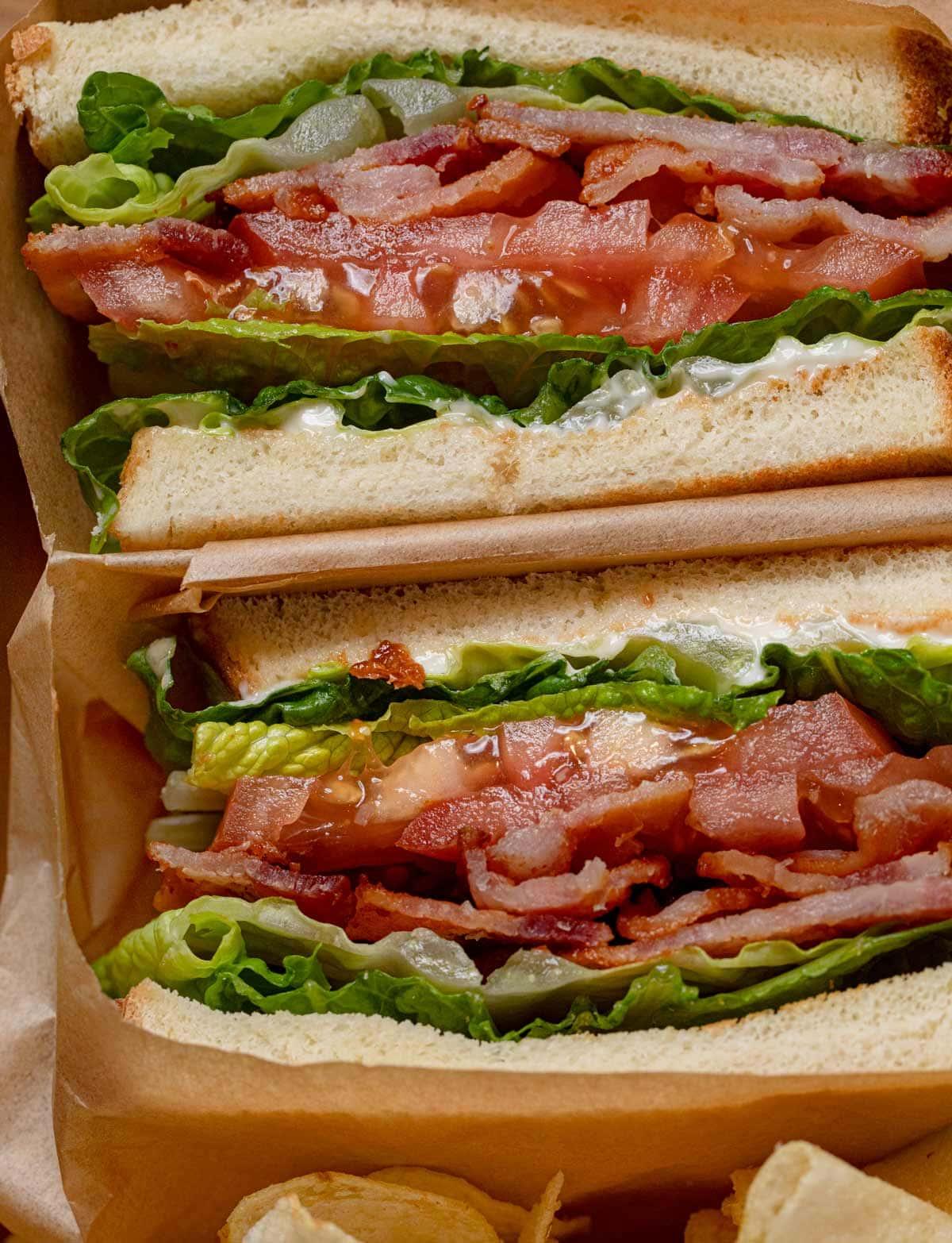 close-up of BLT Sandwich sliced in half