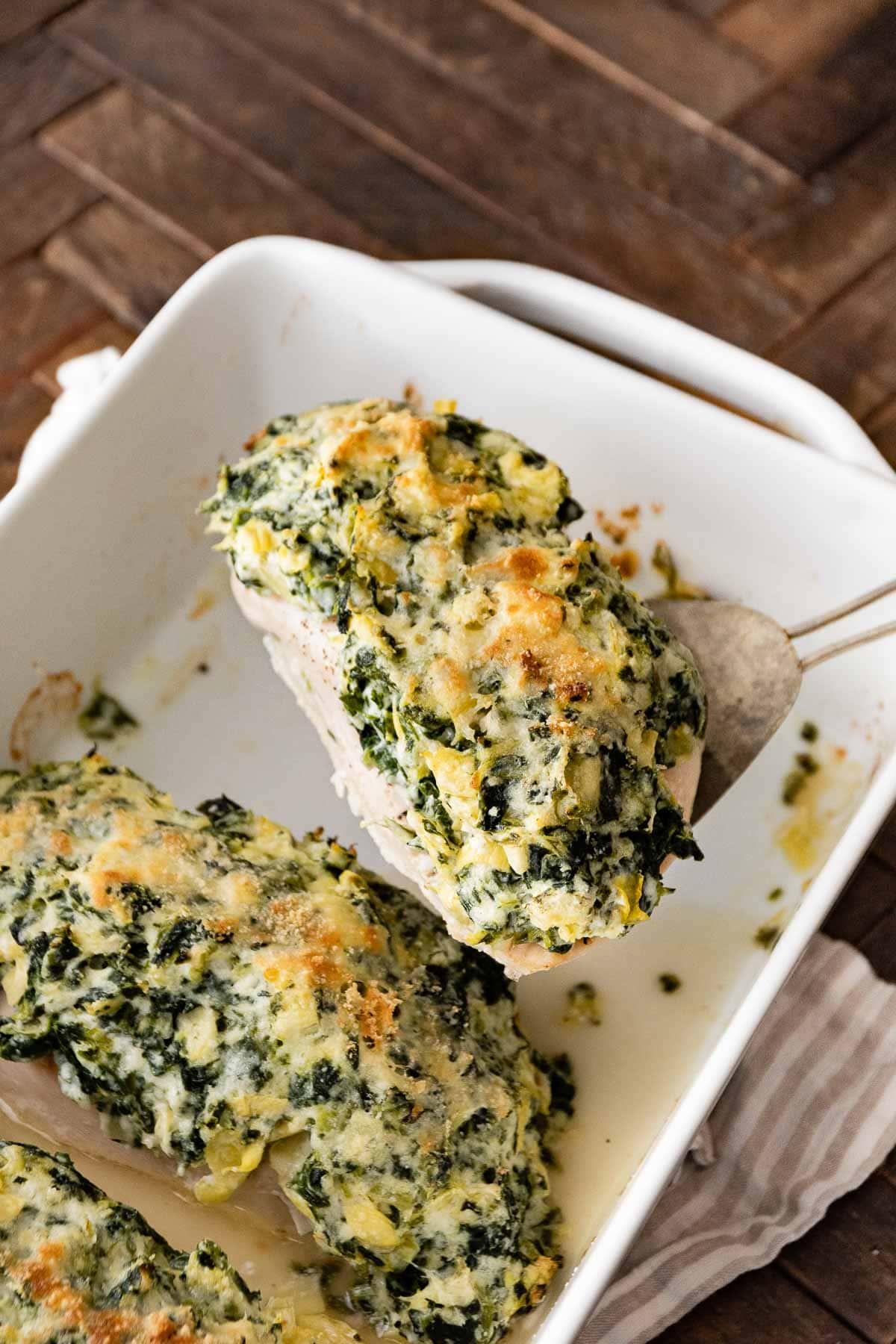 Baked Spinach Artichoke Chicken in baking dish