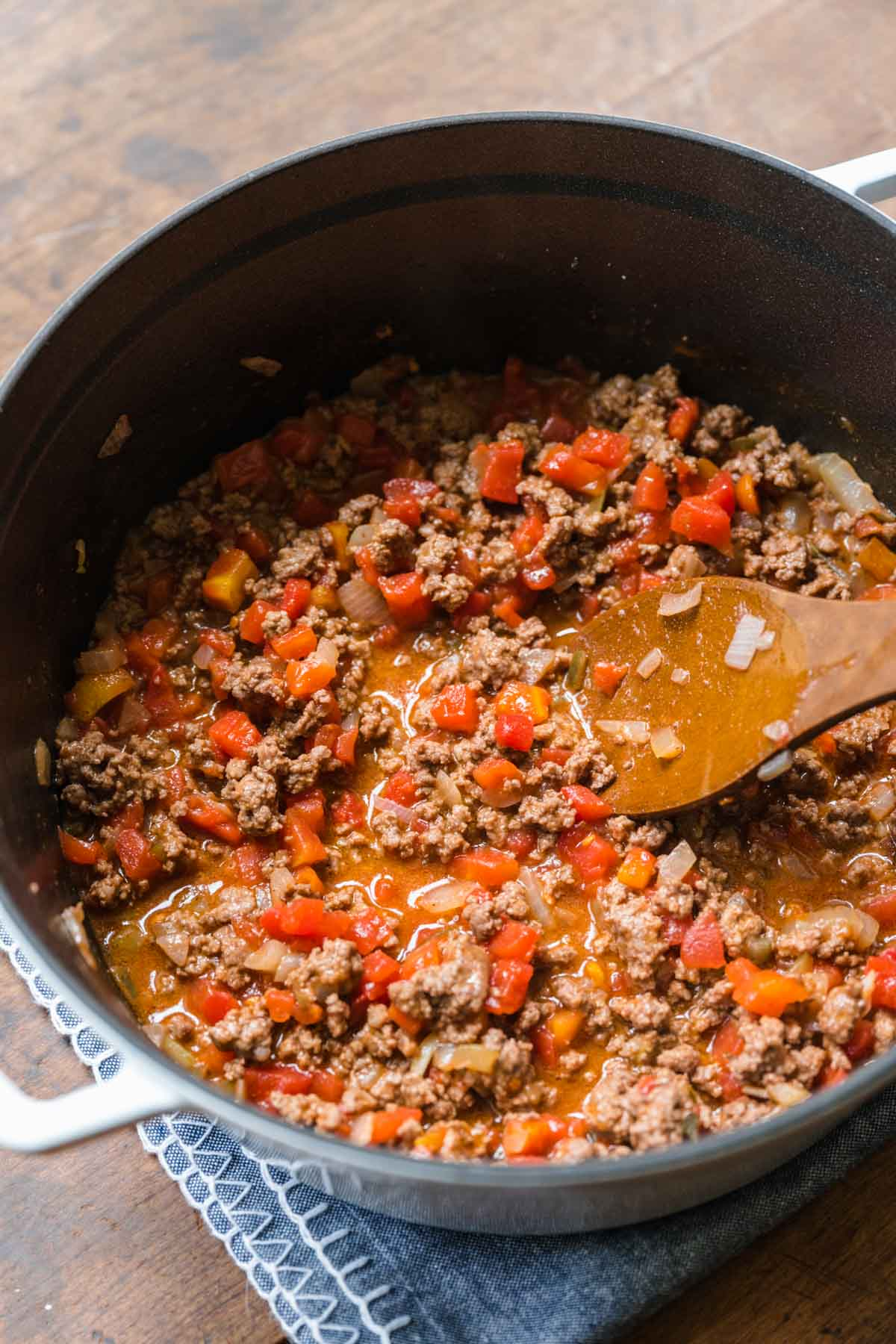 Ground beef with onions and tomatoes for Cheeseburger Pasta