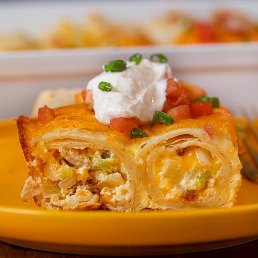 Cheesy Breakfast Enchiladas served on plate