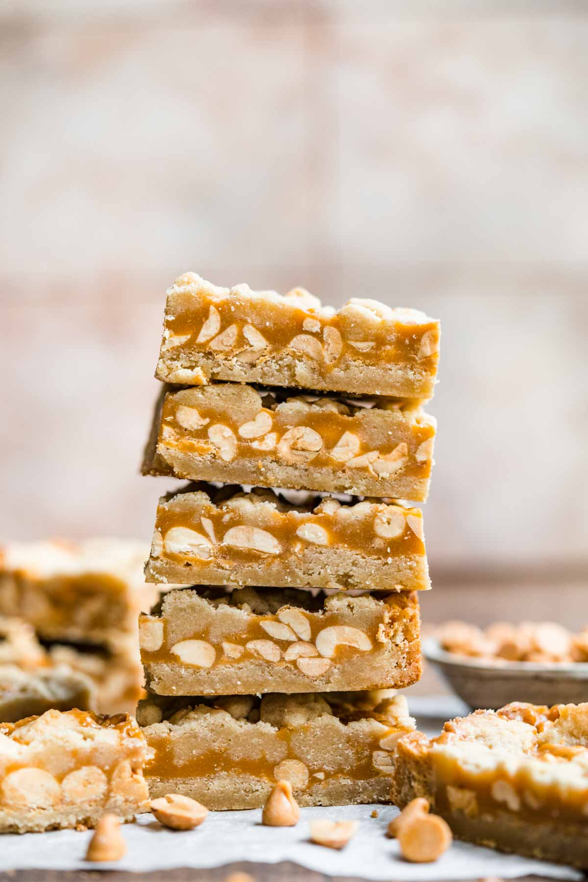 Chewy Peanut Shortbread Bars squares cut and stacked on parchment
