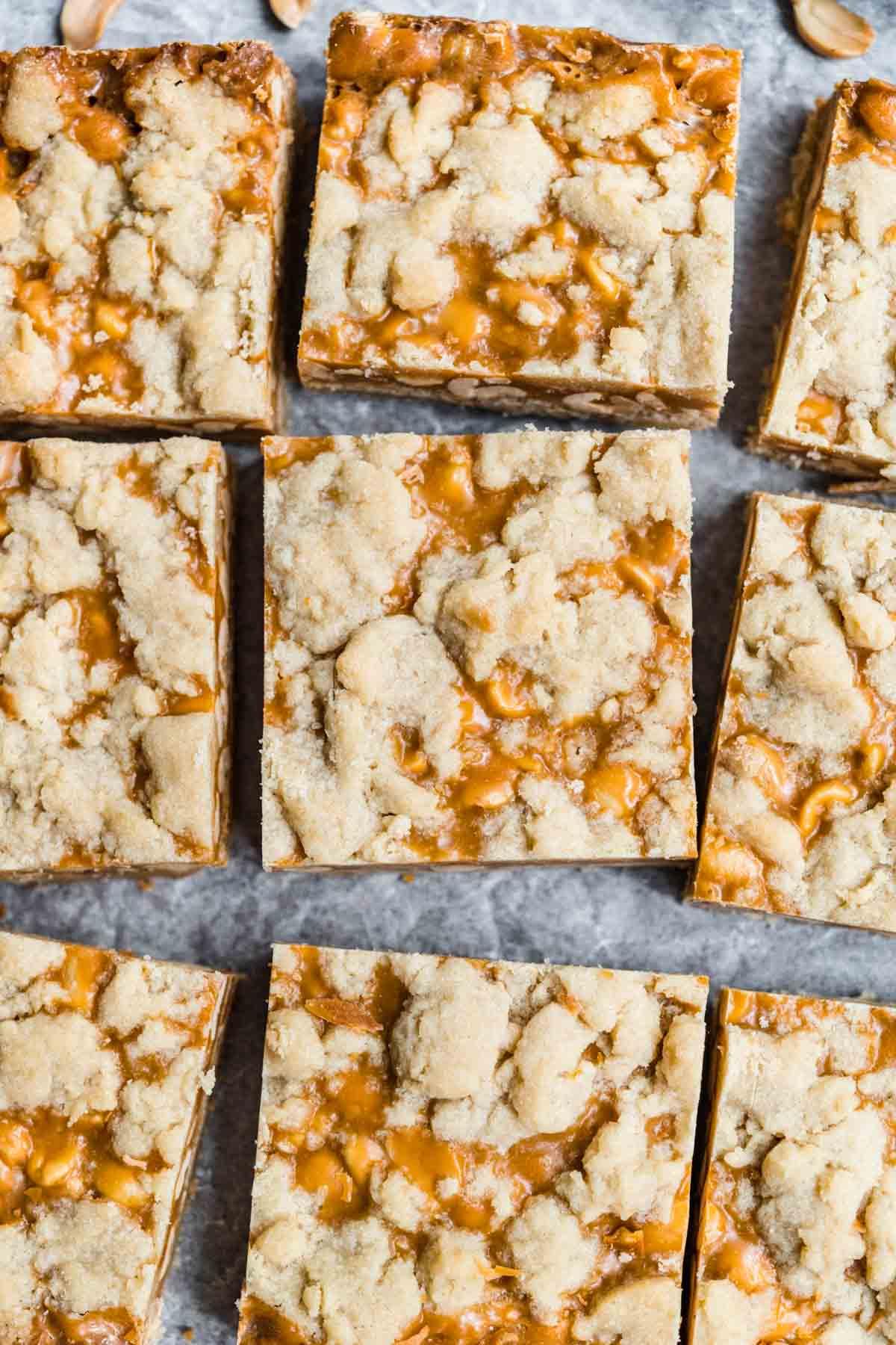 Chewy Peanut Shortbread Bars squares cut on parchment