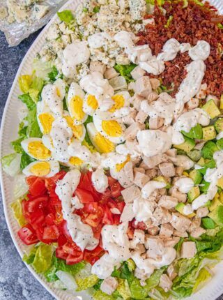 Cobb Salad on serving plate with dressing