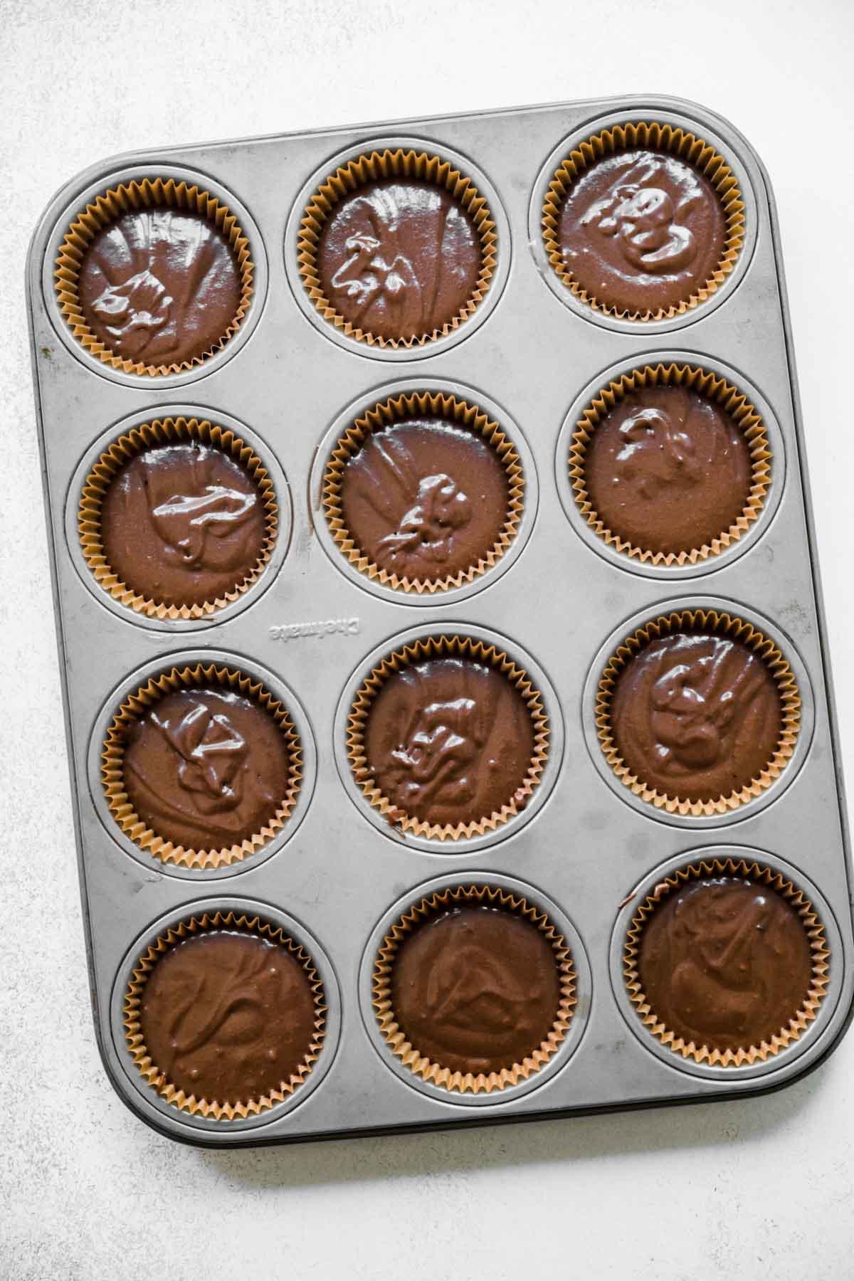 Dark Chocolate Cupcakes batter in cupcake tin