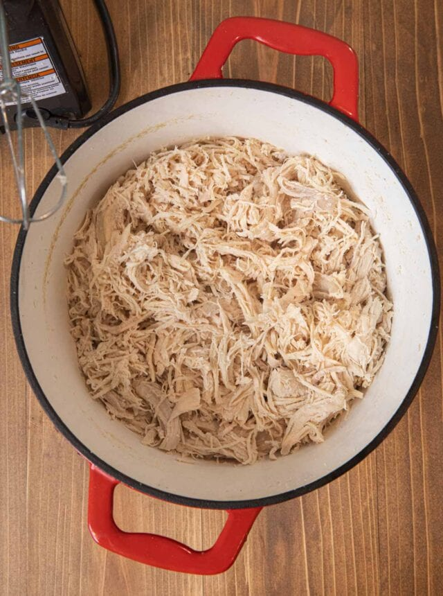 Easy Shredded Chicken in pot with electric mixer