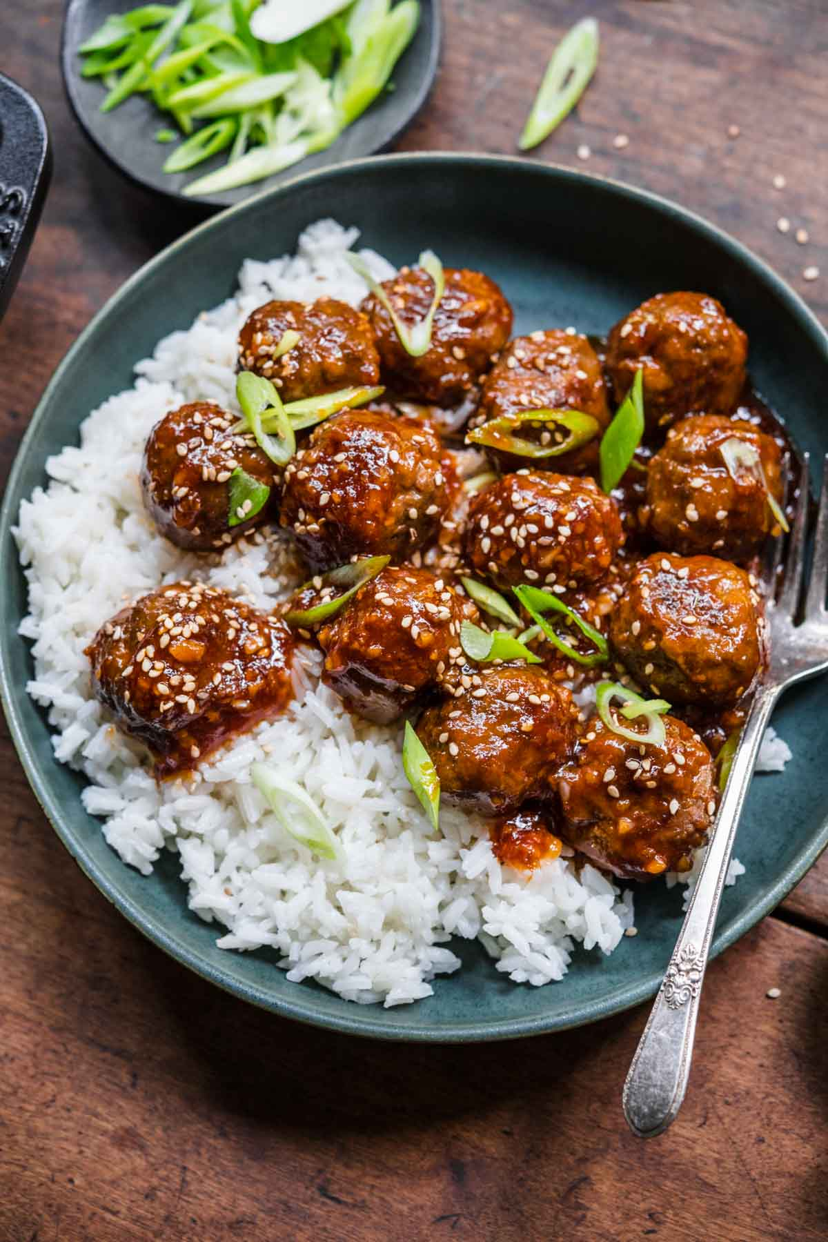 Honey Garlic Meatballs closeup served over rice with fork