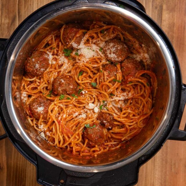Instant Pot Spaghetti and Meatballs in pressure cooker with parmesan cheese