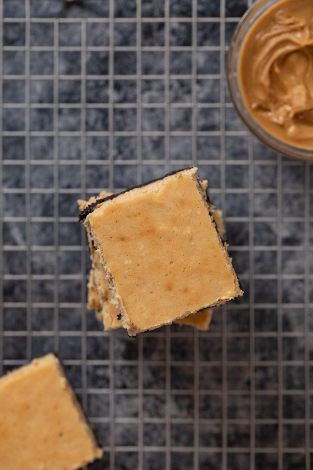 top-down view of Peanut Butter Cheesecake Bars in stack