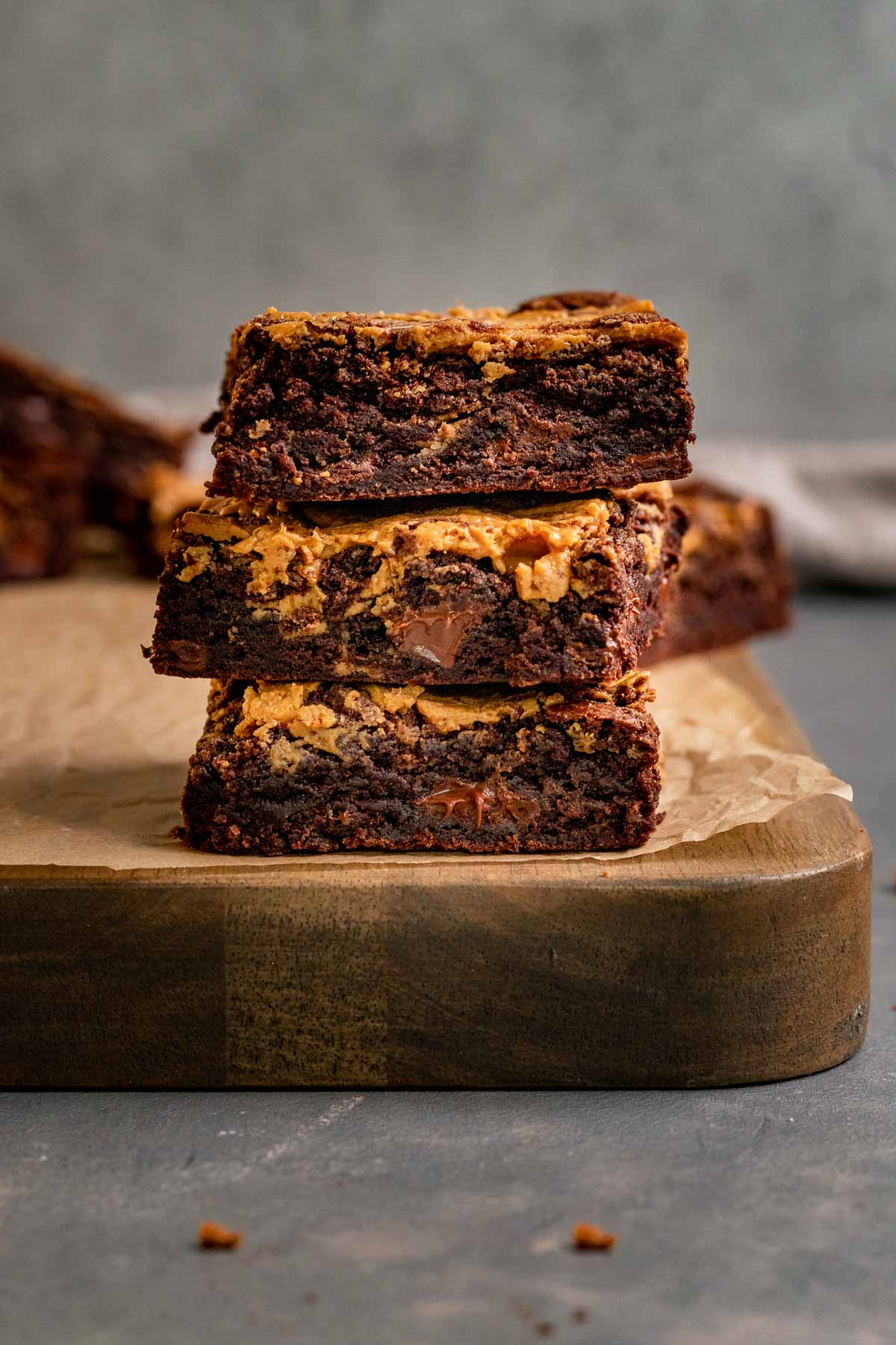 Peanut Butter Swirl Brownies sliced and stacked on cutting board