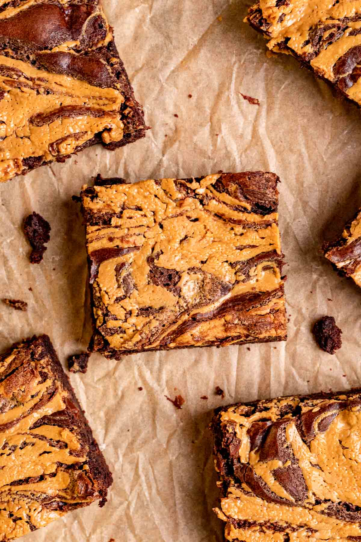 Peanut Butter Swirl Brownies sliced on parchment