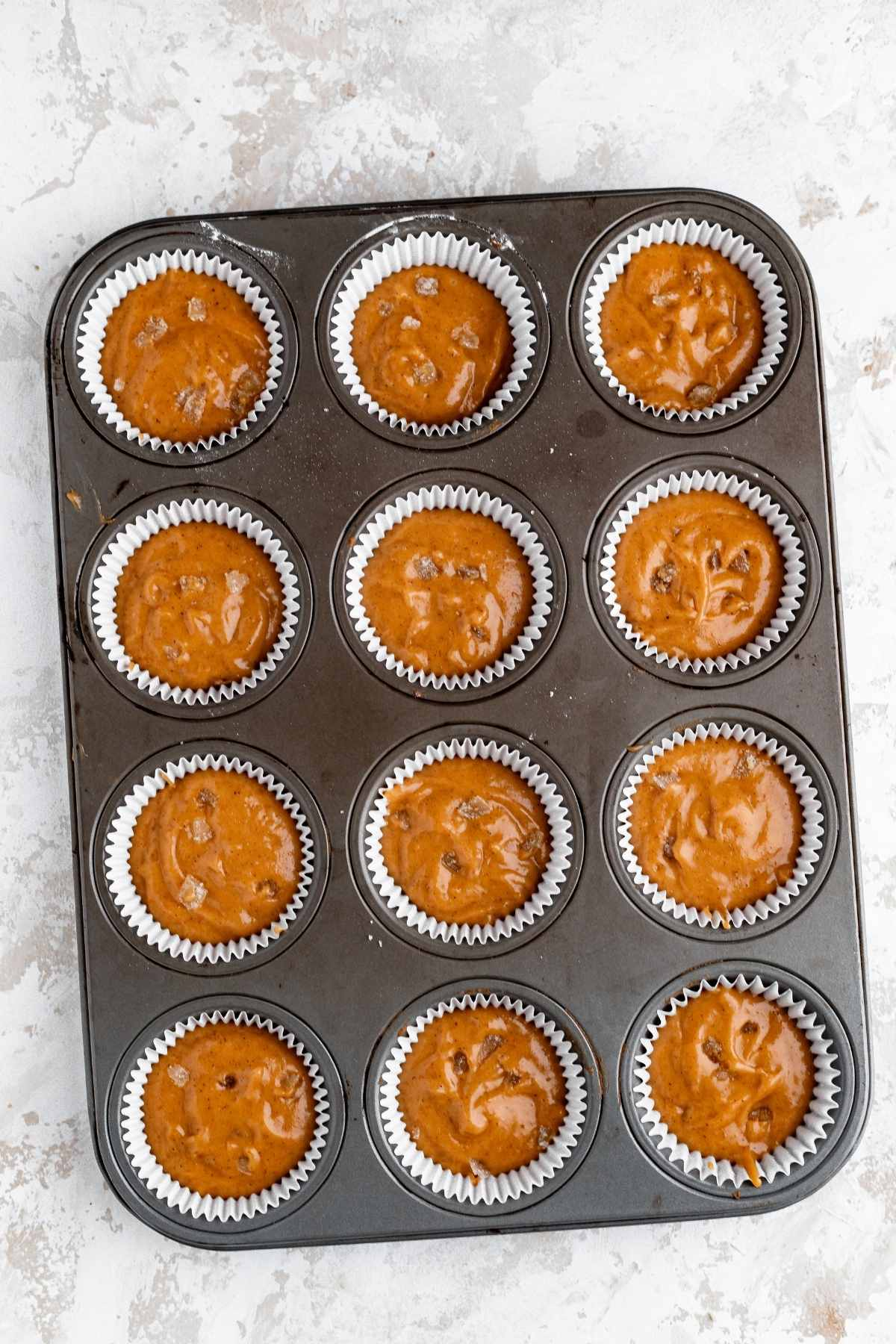 Pumpkin Ginger Cupcakes batter in cupcake pan before baking