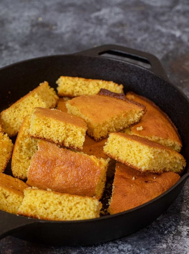 Skillet Cornbread sliced squares in cast iron skillet