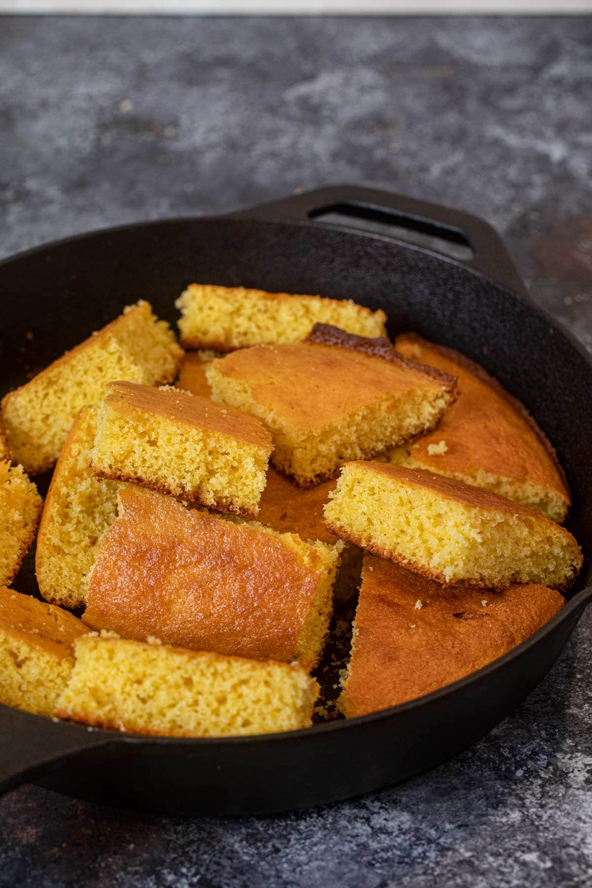 Skillet Cornbread sliced squares in cast iron skillet