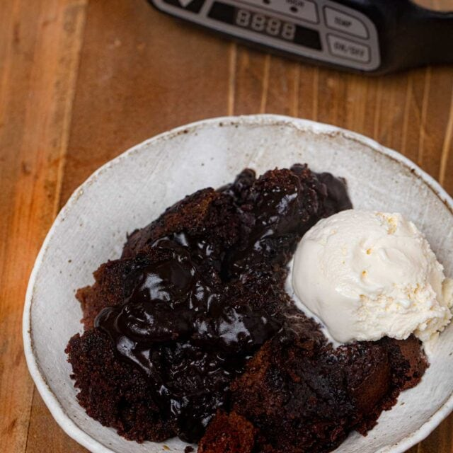 Slow Cooker Lava Cake in bowl with vanilla ice cream